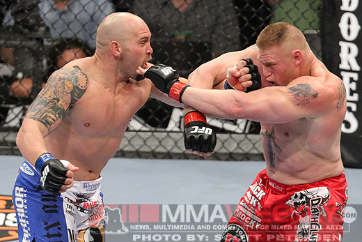 Carwin lands a shot on Lesnar at UFC 116