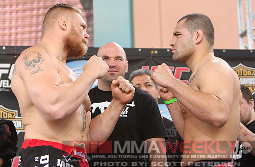 Brock Lesnar faces off with Cain Velasquez at UFC 121 weigh-ins.