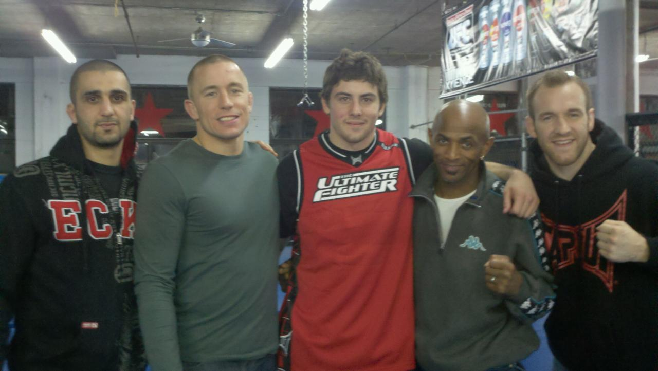 Andy Main with Georges St-Pierre and his team