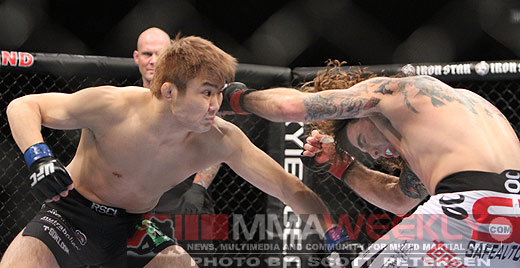 Takanori Gomi and Clay Guida at UFC 125