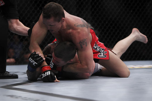 Kyle Noke takes Chris Camozzi's back UFC 127