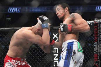 Jose Aldo uppercuts Mark Hominick at UFC 129