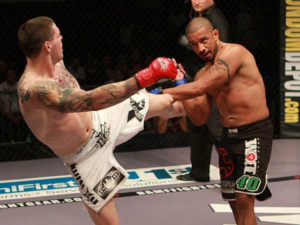 Chris Camozzi throws the kick on Joey Villasenor