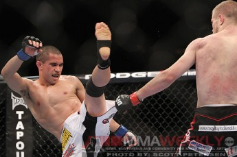 Renan Barao firing off the front kick