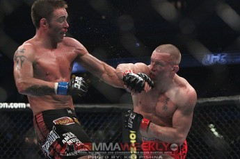 Georges St. Pierre and Jake Shields at UFC 129