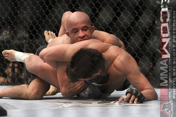 Mighty Mouse grappling with Miguel Torres