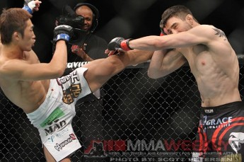 Kim goes with the high kick on Condit