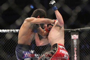 Darren Elkins and Michihiro Omigawa at UFC 131