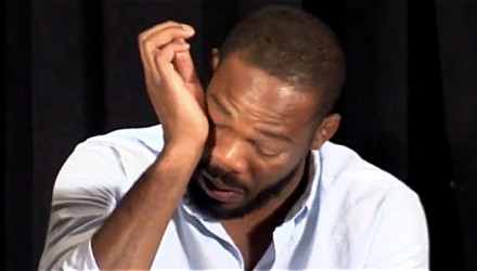 Jon Jones wiping away tears with hand