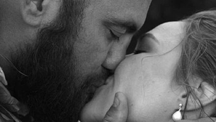 Travis Browne and Ronda Rousey kissing wedding