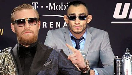 Conor McGregor with belt over Tony Ferguson
