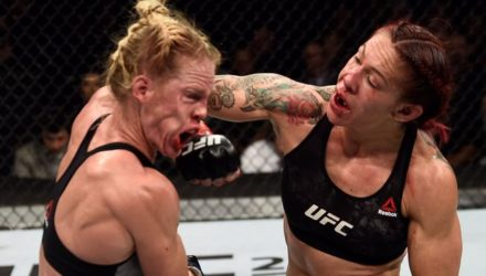Cris Cyborg punches Holly Holm at UFC 219 - UFC Photo
