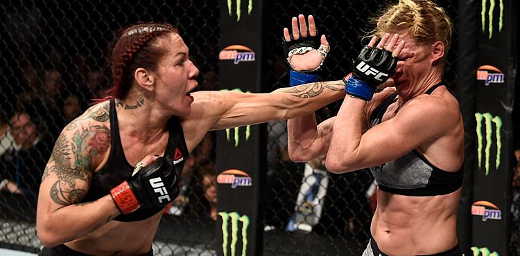 https://cdn.mmaweekly.com/wp-content/uploads/2017/12/Cris-Cyborg-punches-Holly-Holm-to-cage-UFC-219-UFC-photo.jpg