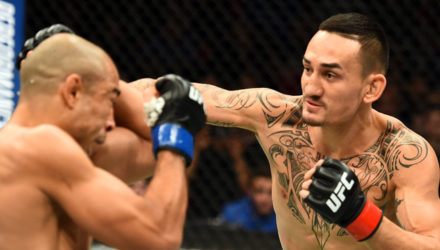 Max Holloway punches Jose Aldo at UFC 218
