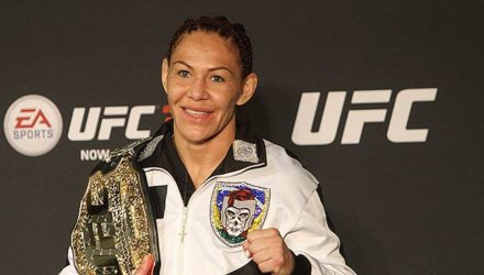 Cris Cyborg with UFC belt at UFC 222 post-fight press conference