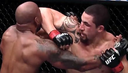 Robert Whittaker elbows Yoel Romero at UFC 225