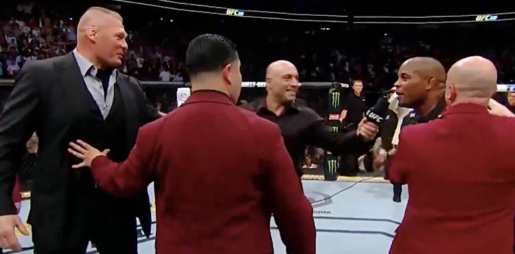 https://cdn.mmaweekly.com/wp-content/uploads/2018/07/Brock-Lesnar-and-Daniel-Cormier-yelling-at-UFC-226.jpg