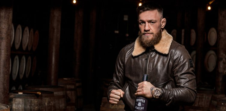 Conor McGregor with bottle of Proper No 12