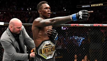 Dana White puts the belt on Israel Adesanya at UFC 236