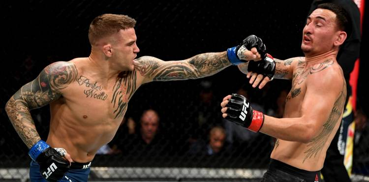 Dustin Poirier punches Max Holloway at UFC 236