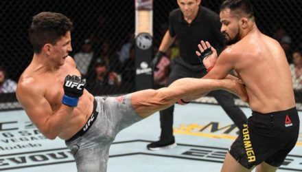 Joseph Benavidez lands kick on Jussier Formiga at UFC on ESPN 3