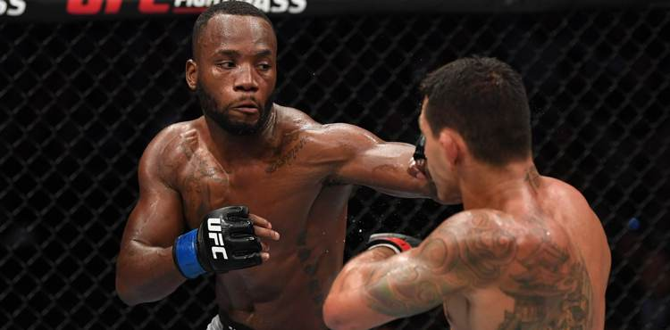 Leon Edwards punches Rafael dos Anjos at UFC on ESPN 4