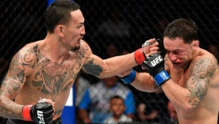 Max Holloway punches Frankie Edgar at UFC 240