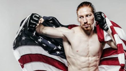 Spike Carlyle with US flag - Combate Americas