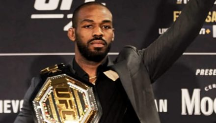 Jon Jones UFC 247 arm raised with belt