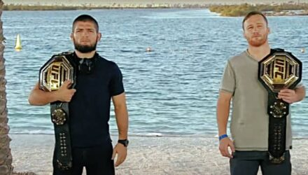 Khabib Nurmagomedov and Justin Gaethje with belts UFC 254 on beach