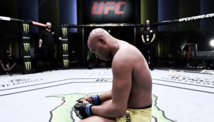 Anderson Silva kneels in Octagon at UFC Vegas 12