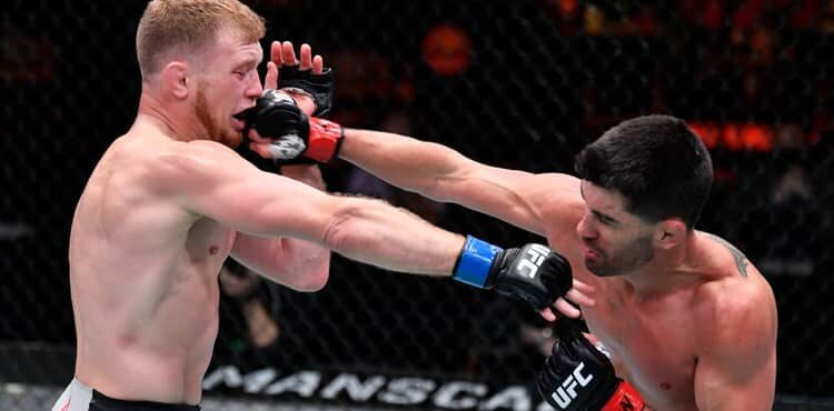 Dominick Cruz punches Casey Kenney at UFC 259