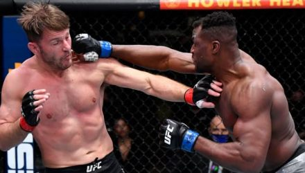 Francis Ngannou punches Stipe Miocic at UFC 260