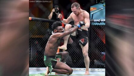 Petr Yan knees Aljamain Sterling at UFC 259