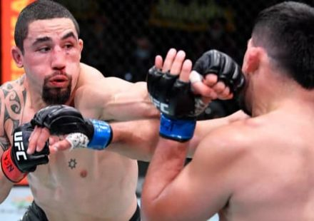 Robert Whittaker punches Kelvin Gastelum at UFC Vegas 24